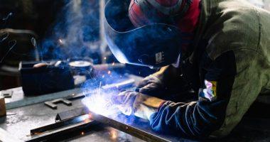 man-welding-metal-bars-2381463